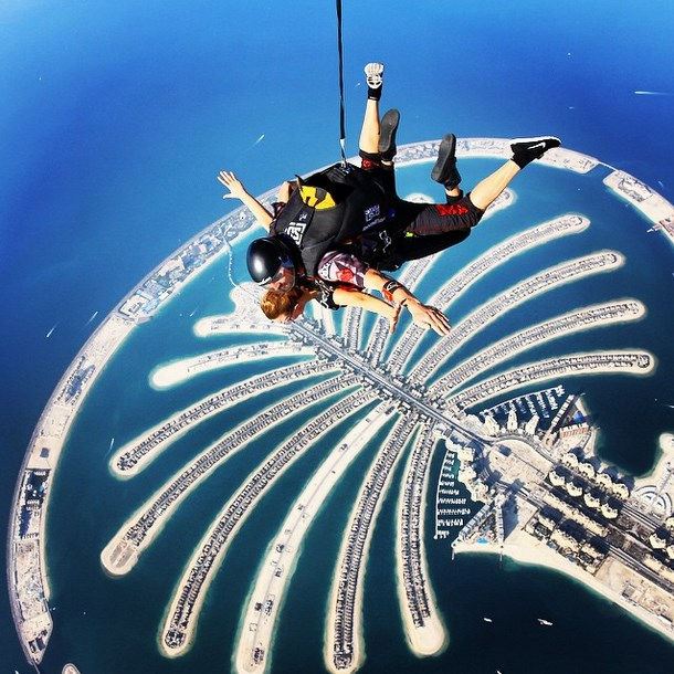 "Victoria's Secret model @josephineskriver: ""the palm #skydivedubai #mydubai #bukhashbrothers"""